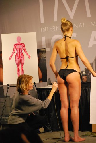 Katie Quinn Teaches Makeup Artists How To Contour in Spray Tanning at IMATS LA